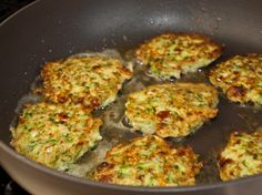Zucchini -fritters- feta & dill 1 pound zucchini (about 2 medium), trimmed 1 teaspoon salt 2 large eggs 2 scallions, minced 2 tablespoons minced fresh dill 1/2 cup crumbled feta cheese 1 medium garlic clove, minced or pressed through a garlic press 1/4 teaspoon black pepper 1/4 cup corn starch or all purpose flour 1/2 teaspoon baking powder 6 tablespoons olive oil Lemon wedges, for serving