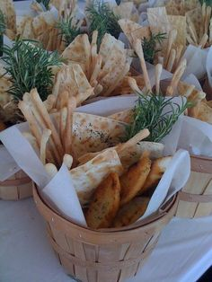 mini baskets of bread along the tables, plus dishes of olives and nuts would be lovely