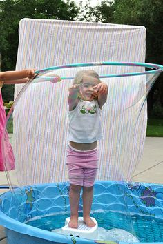 In class, we love bubbles and hula hoops! Why not combine the two for hula hoop sized bubbles?