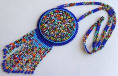 Hey, I found this really awesome Etsy listing at https://www.etsy.com/listing/196647536/mexican-huichol-beaded-necklace-pouch