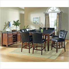 Bello Granite 9-Pc Counter Height Dining Set by Steve Silver by Steve Silver. $1349.99. Bello Granite 9-Pc Counter Height Dining Set by Steve Silver The perfect complement to any dinner, the Bello Granite Counter Height Dining Set by Steve Silver will inspire intriguing dinner conversations and the irresistible style will provide a sanctuary for all the senses. The table features a black granite top and legs wrapped in a rich cherry finish. The Counter Height Parsons Chairs ar...