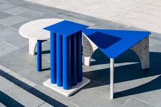 Design by Davide G. Aquini. TuttoSesto is a collection of coffee tables looking like microarchitectures recalling, with their name, the playful Neoclassicism of the 80s. They are made of travertine, an iconic stone from ancient Italian history, deliberately juxtaposed to vibrant and deep Klein blue.
