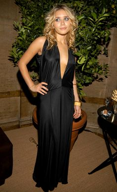 OLSENS ANONYMOUS ASHLEY OLSEN FASHION STYLE GET THE LOOK BLOG LOW CUT MAXI SILK GOWN DRESS CURLY HAIR YELLOW BANGLE GOLD BRACELETS FENDI 80th ANNIVERSARY All Hallows Eve Party hosted by KARL LAGERFELD 2005