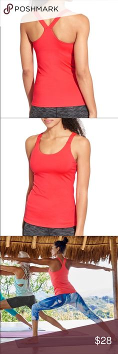 Athleta Optimism Tank 2 Fitted. Fits next to the skin. MID COVERAGE. Lower cut neckline offers just-right coverage for the girls. Color is Coral Quest. Size is XL. Athleta Tops