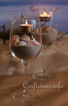 Beach wedding table decorations - fill wine glasses with sand and your favorite seashell medley and illuminate with tea lights. Perfect for the beach wedding or