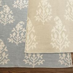 Love this (tan) one for the dining room...would match the kitchen color. Paint Fireplace wall same as kitchen to tie all rooms together. Could also use the gray one in dining room and paint fireplace gray too (comfort gray?). I like tan option better, but both could work!  Liza Paisley Dhurrie Rug