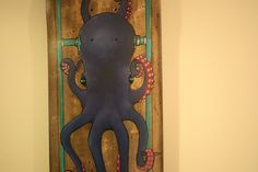 Octopus on recycled skateboard. $105.00, via Etsy.