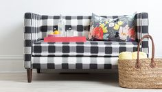 The Dylan settee is sleek and sophisticated. With it's mid-century legs and button tufting, we love to pair it's clean lines with feminine pillows! Shown in Black Buffalo Check. Textures may vary base