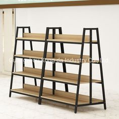 Supermarket Store Wooden Metal Shelf Display Rack Stand Usage : Beverage, Supermarket, Food, Industrial, Warehouse Rack. Material : Steel and Wood. Structure : Shelf. Type : Multi-Level Racking. Mobility : Combined. Height : 0-5m. Weight : <100kg. Closed : Open. Development : Conventional. Serviceability : Common Use. Payment : T/T,Western Union,L/C. Experience : Since 2003. Production Time : About 18 Days. Keyword : Display Stand. Advantage : Eco-Friendly. Color : Customized Design. Service : D Shop Shelving, Retail Shelving, Display Shelves, Supermarket Design, Retail Store Design, Boutique Interior, Shop Interior Design, Clothing Store Design, Pharmacy Design