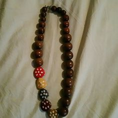 Necklace Handmade wooden beaded necklace.   Splashes of colored beads,  red, yellow,  purple, magenta, tan. Jewelry Necklaces