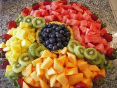 For our fruit tray, leave out the kiwi (allergic) - watermelon, cantaloupe, pineapple, blueberries, strawberries