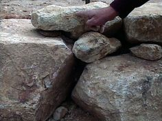 How to build a retaining wall with boulders.