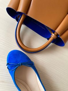 If you're after something bolder this winter, how about our latest favourite colour: cobalt blue? Accessories can add a nice pop of colour to an outfit and cobalt blue is fun and sporty, especially in our perforated bucket bags and inside our tan tote bags. Inject a little colour into your wardrobe with our range of leather bags and ballet flats. Italian Leather Handbags, Designer Leather Handbags, Leather Bags, Navy Blue Handbags, Tan Tote Bag, Foldable Ballet Flats, Bucket Bags, Italian Shoes, How To Make Handbags