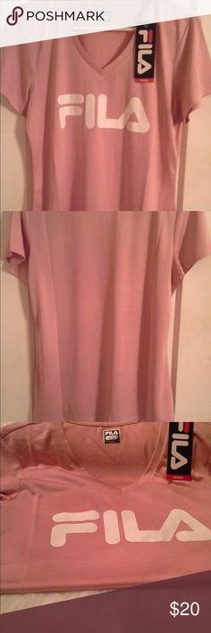 5b0e2f7bd41056 FILA Large logo women s tee (size medium) 🔥 Fila tee. Shirt women s size  medium Tops Tees - Short Sleeve
