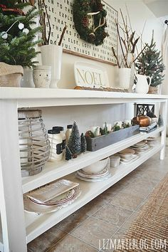 Love this open shelf side table in this Christmas decorated dining room—nice styling too❣ Liz Marie Blog