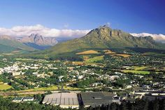 Stellenbosch with Gilbeys in foreground and Jonkerhoek mountain in background. Eternal Sunshine, Short Break, Homeland, South Africa, Paris Skyline, Travel Inspiration, Dolores Park, Explore, Adventure