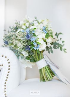 Gorgeous cream, white, blue, lilac bridal wedding bouquet by KDJ Botanica. Photographed by Melani Lust Photography at Westchester Country Club, NY.