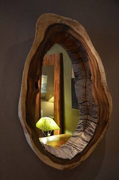 Stunning mirror framed in a sliced tree trink.