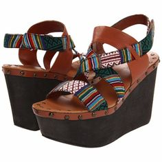 Joe's Jeans Boho Ethnic Aztec Strappy Studs Wedges Show off your free spirited bohemian side in this Joe's Jeans wedge. Features printed fabric upper and cognac leather straps. Studs line the 4 inch wedge and 2 1/2 inch platform to perfect this sandal. Only flaws are in the last pictures. Worn twice only. Fit true to size. Velcro straps. ❌No trades or modeling. Thanks for visiting my closet and reasonable offers are always welcome‼️ Joe's Jeans Shoes Wedges