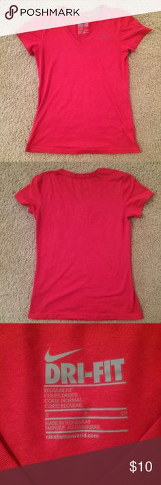 Red Nike Dry-Fit Top Pink-ish Red Dry-Fit shirt by Nike. Worn a few times but in great condition! Fitted style. Nike Tops Tees - Short Sleeve