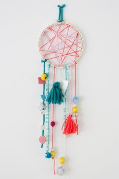 Kid made dream catchers - Love this simple but cute version!