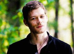 Klaus chasing Caroline around the woods