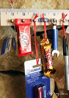 Turn a wooden yardstick into the perfect Advent Calendar for boys! Countdown to Christmas with a small treat or tool everyday. Supplies For Wooden Yardstick Advent Calendar: 25 small tool and or candies, 2 small eye hooks, 25 furniture nails, 1 wooden yardstick, ribbon or wire for hanging.