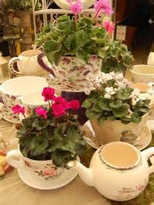 Teacup Planters: finally found something to do with grandmas china that has been in a box this whole time! The hubby will be happy ;)