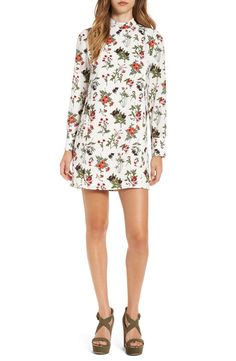 Swooning over this floral-print shift dress with a season-right mock neck and button-cuff long sleeves. A slender keyhole spans the length of the back to finish the look with just a flash of skin.