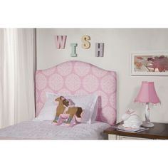Dress up your little girl's twin bed with the fun pink and white medallion pattern of this precious headboard. Graceful curves make this headboard a fashionable asset to the room of any little princess.
