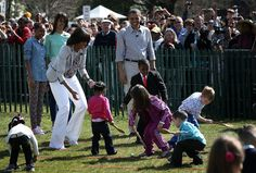 Malia Obama Photos Photos - U.S. President Barack Obama (4th L), first lady Michelle Obama (3rd L), daughters Sasha (L) and Malia (2nd L), and Robby Novak (R), who also known as the Kid President, watch as children participate during the annual White House Easter Egg Roll on the South Lawn of the White House April 1, 2013 in Washington, DC.  President Obama and first lady Michelle Obama hosted thousands of people during the annual celebration of Easter. - The First Family Hosts Annual…