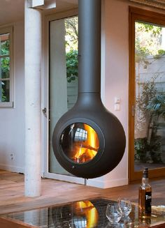 Natural or artificial fireplace models can make both modern and rustic home decorations look highly aesthetic. Artificial fireplace models are general. Contemporary Fireplace Designs, Modern Fireplace, Contemporary Design, Log Burner Fireplace, Wood Burner, Artificial Fireplace, Wood Pellet Stoves, Freestanding Fireplace, Bedroom Fireplace