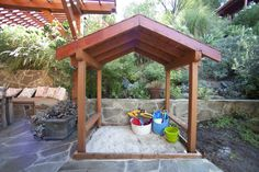 I love how this sandbox is incorporated into the overall design. When the kids get older, it could become a great covered outdoor eating area.