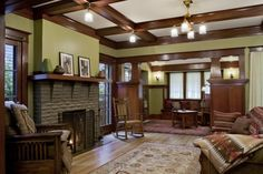 Love the ceiling beams and colour of all the wood trim!   Laurelhurst 1912 Craftsman living room after - like the wall color as an accent wall
