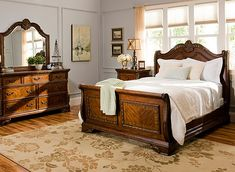 This Catalina 4-pc. queen bedroom set is undeniably beautiful. Its breathtaking traditional design will enrich your bedroom with its book-matched veneers, raised decorative carvings, gold-tipped highlights, antiqued brass hardware, beveled-glass mirror and warm cognac finish. As if all that's not enough to tempt you, just wait till you check out the deeper-than-usual dresser drawers.