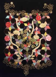 Silk velvet Victorian patchwork quilt background overlayed with  antique lace, gold embroidery from a vintage Kimono and velvet flower spray from a vintage hat.