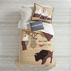 Bring a bit of the outdoors into your bedroom with our Nature Lodge Quilt. Featuring a combination of intricate embroidery and beautiful applique, it's adorned with some of nature's favorite animals. Designed just for us by Tamar Mogendorff.<br /><br /><NEWTAG/><ul><li>Nod exclusive</li><li>A Tamar Mogendorff design</li><li>Quilt features an appliqued and embroidered buffalo, deer and eagle</li><li>Quilt reverses to solid brown</li><li>To order complimentary swatches, please email…