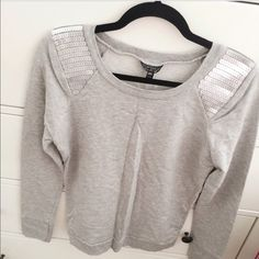 TopShop grey sweater top with sequins New without tags TopShop grey long sleeved top with sequins on shoulders! Beautiful on! Never worn. Size 2, fits like XS/S. Topshop Tops