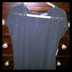 Woven Top Brand New. Never worn top. Black with gold tiny rain drop embellishment. It has gold/yellow buttons going  down on the back of the top. Wonderful to wear with some denim jeans and black pumps for a night out of town especially in the summer. Forever 21 Tops Tees - Short Sleeve