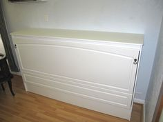 Twin Murphy Bed In White Cabinet