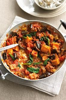 Roasted aubergine, sweet potato and spinach curry. Photographed by William Reavell