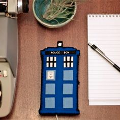 Step up your geek game with a TARDIS phone charging station with free printable pattern!