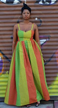 African fabric red, gold and green maxi dress. This dress has the right amount of style and back drama necessary to stand out at any event.  African print red, yellow and green lace up back maxi dress.  Ankara | Dutch wax | Kente | Kitenge | Dashiki | African print bomber jacket | African fashion | Ankara bomber jacket | African prints | Nigerian style | Ghanaian fashion | Senegal fashion | Kenya fashion | Nigerian fashion | Ankara crop top (affiliate)