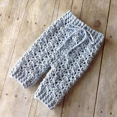 This is a PDF crochet pattern for a pair of uniquely-textured baby pants in 2 sizes, perfect for newborn photography. This pattern coordinates perfectly with my Diagonal Spike Stitch Baby Bonnet pattern.