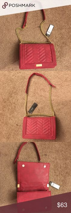 "BCBG Paris Matte Quilted Chain Purse Tomato Bag BCBG Paris Matte Quilted Chain Purse Tomato color Bag.  - Retail at $168.  - Never used !! - New with tags BCBG quilted chain tomato color bag with gold-tones hardware with 11"" to 17""  adjustable chain straps.  - Beautiful BCBG front logo.  - Can be worn long like a cross body or short like a hand bag as well as over your shoulder!  - Interior compartments with 1 zip pocket and 2 slip pocket.  - Dimensions: 3""(D) X 7""(H) X 11""(L).   - retails…"