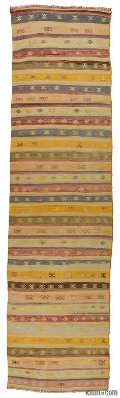 Vintage Turkish kilim runner rug embroidered with small jijims. This kilim was hand-woven in the Konya region of Central Anatolia, Turkey around 70 years ago.
