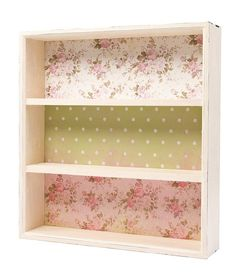 DIY: Vintage Style Shelves - cover the back of an inexpensive bookshelf with fabric.