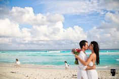 Cute photo from a Vow Renewal with kids running in the back   Take it Photo + Cancun + Vow Renewal + Photography