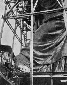 France - c.1883, a giant scaffold supports the Statue of Liberty, before it is dismantled for shipping and reassembly in New York, during America's Gilded Age. ~ {cwl} ~ (Image: Examiner)
