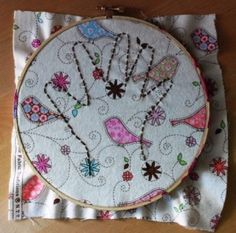 embroider your child's hand print.